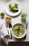 Green lunch for one person. Ð¡ream soup with green peas stock image
