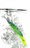 Green lure making a splash in water on white background Stock Image