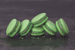 Green macarons on dark table Royalty Free Stock Image