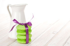 Green macarons with purple ribbon Royalty Free Stock Image