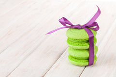 Green macarons with purple ribbon Stock Photo