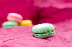 Green macaroon in the focus Royalty Free Stock Images