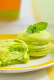 Green macaroon with mint leaves Stock Photos