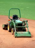 Green Machine. A green landscaping machine on a baseball field royalty free stock photography