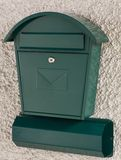 Green mailbox and newspaper holder. Bright green postbox and newspaper holder royalty free stock images