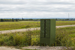 A green mailbox by the roadside Stock Images
