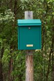 Green mailbox on wooden post Stock Photography