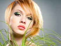 Green make-up. Beautiful woman face with green makeup Stock Photography