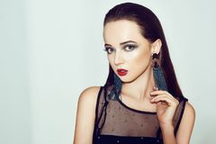 Green makeup. Beautiful girl with makeup isolated on background. Eye make-up and sensual lips. Elegant hairstyle. Brunette stock photography