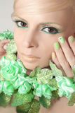 Green makeup and nail Polish. Green makeup and nail Polish with sparkles and rhinestones of different shapes royalty free stock image