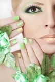 Green makeup and nail Polish. Royalty Free Stock Photography