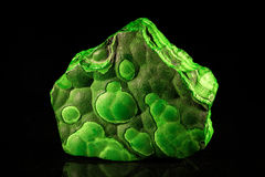 Green malachite in front of black Stock Photo