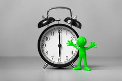 Green man and an alarm clock. Royalty Free Stock Photo