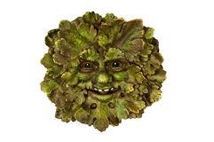 Green man pagan icon in oak leaves, close up image stock photography