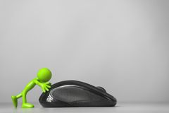 Green man pushing a computer mouse. Royalty Free Stock Photos