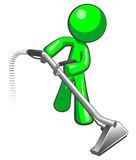 Green Man with Steam Cleaner Carpet Wand. Extracting floor Royalty Free Stock Images
