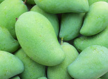 Green mango fruit. Fresh a green mango fruit in the pile Royalty Free Stock Images