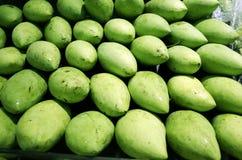 Green mango. The mangoes piled together Stock Image
