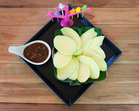 Green mango sliced with sweet and spicy sauce Royalty Free Stock Image