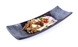 Green mango spicy salad with crispy fish on plate Royalty Free Stock Images