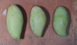 Green mango on the wood Stock Photos