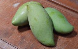 Green mango on the wood Royalty Free Stock Photo