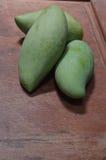Green mango on the wood Royalty Free Stock Image