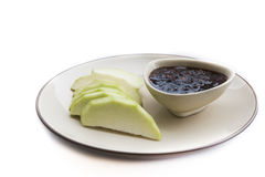 Green mangoes dipped sweet fishy paste Stock Image