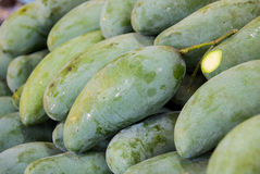 Green mangoes. In the fresh market Royalty Free Stock Image