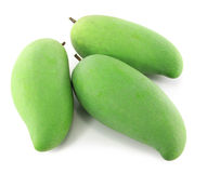 Green mangoes on a white background. Green mangoes isolated on a white background Stock Photos