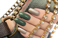 Green manicure. Royalty Free Stock Images