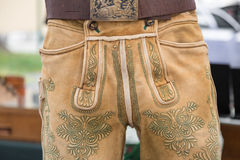 Green manual embroidery on deerskin leather trousers Royalty Free Stock Photography