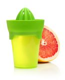 Green manual juicer and citrus fruit Royalty Free Stock Image