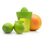 Green manual juicer and citrus fruit Stock Photo