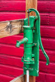 Green manual pump from well Stock Images