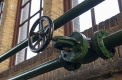 Green manual valve in green metal tube Royalty Free Stock Photo