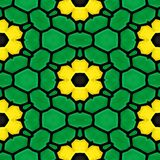 Green marble stony mosaic seamless pattern texture background. With yellow flowers Royalty Free Stock Photography