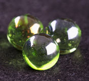 Green marbles in close up Stock Photo