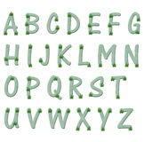 Green and marijuana leaf alphabet letters Stock Images