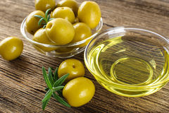 Green marinated olives, olive oil. Royalty Free Stock Image