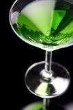 Green martini. Green drink on black background Royalty Free Stock Photography
