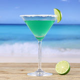 Green Martini cocktail drink on the beach Royalty Free Stock Photo