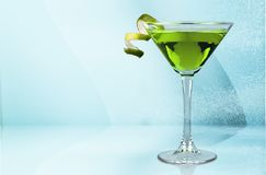 Green Martini cocktail in glass on background Royalty Free Stock Photos