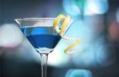 Green Martini cocktail in glass on blurred Royalty Free Stock Images