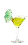 Green martini with an umbrella Royalty Free Stock Photo
