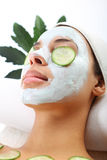 Green mask, woman in spa salon. Cosmetic moisturizing mask is applied to the face of a woman Royalty Free Stock Photo