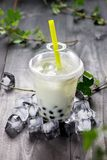 Green matcha bubble tea and black tapioca pearls on crushed ice Royalty Free Stock Photos