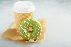 Green matcha glazed donut with cherry Stock Photos