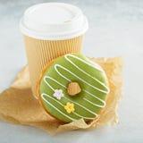Green matcha glazed donut with cherry Royalty Free Stock Photo