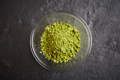 Green matcha powder in glass bowl Royalty Free Stock Photo
